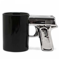 Фото Чашка Пистолет с серебряной ручкой